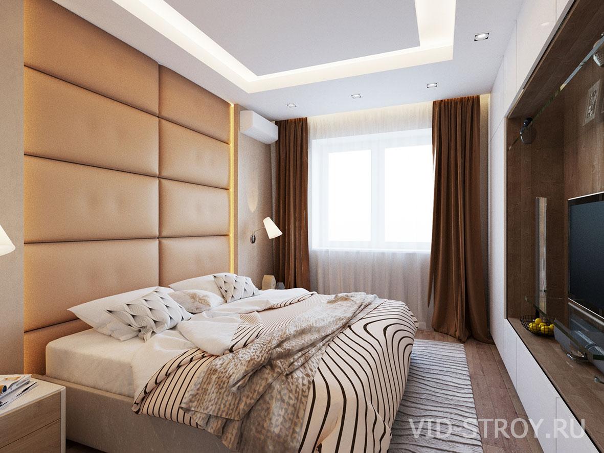 Спальня с мягкими панелями на стене