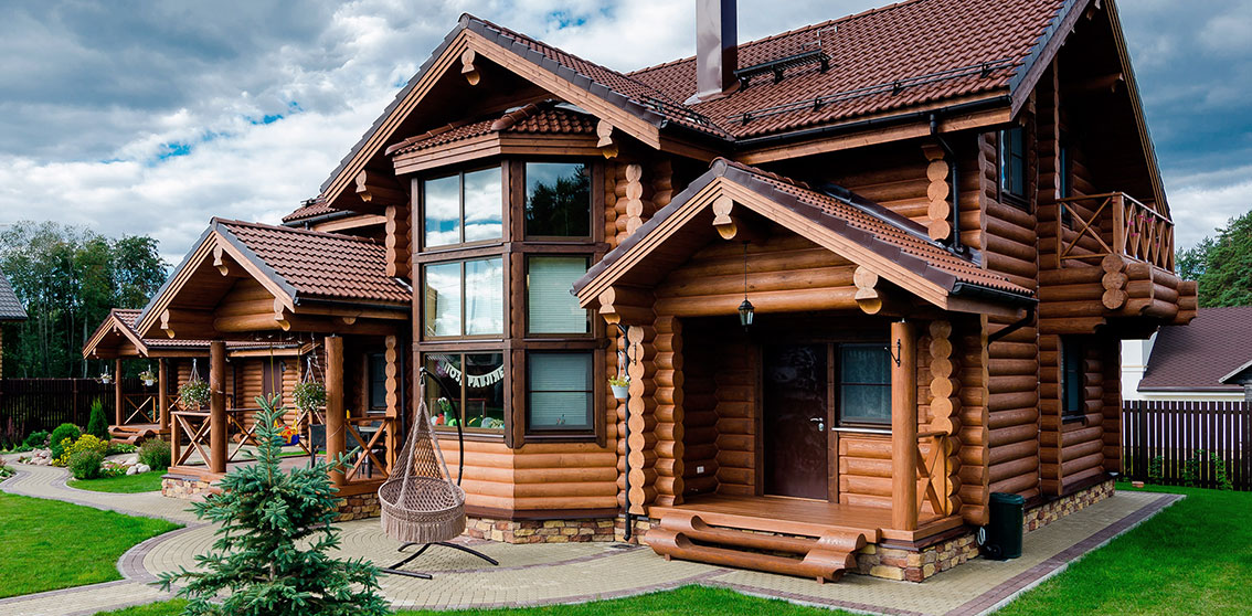 Современный дом из оцилиндрованного бревна