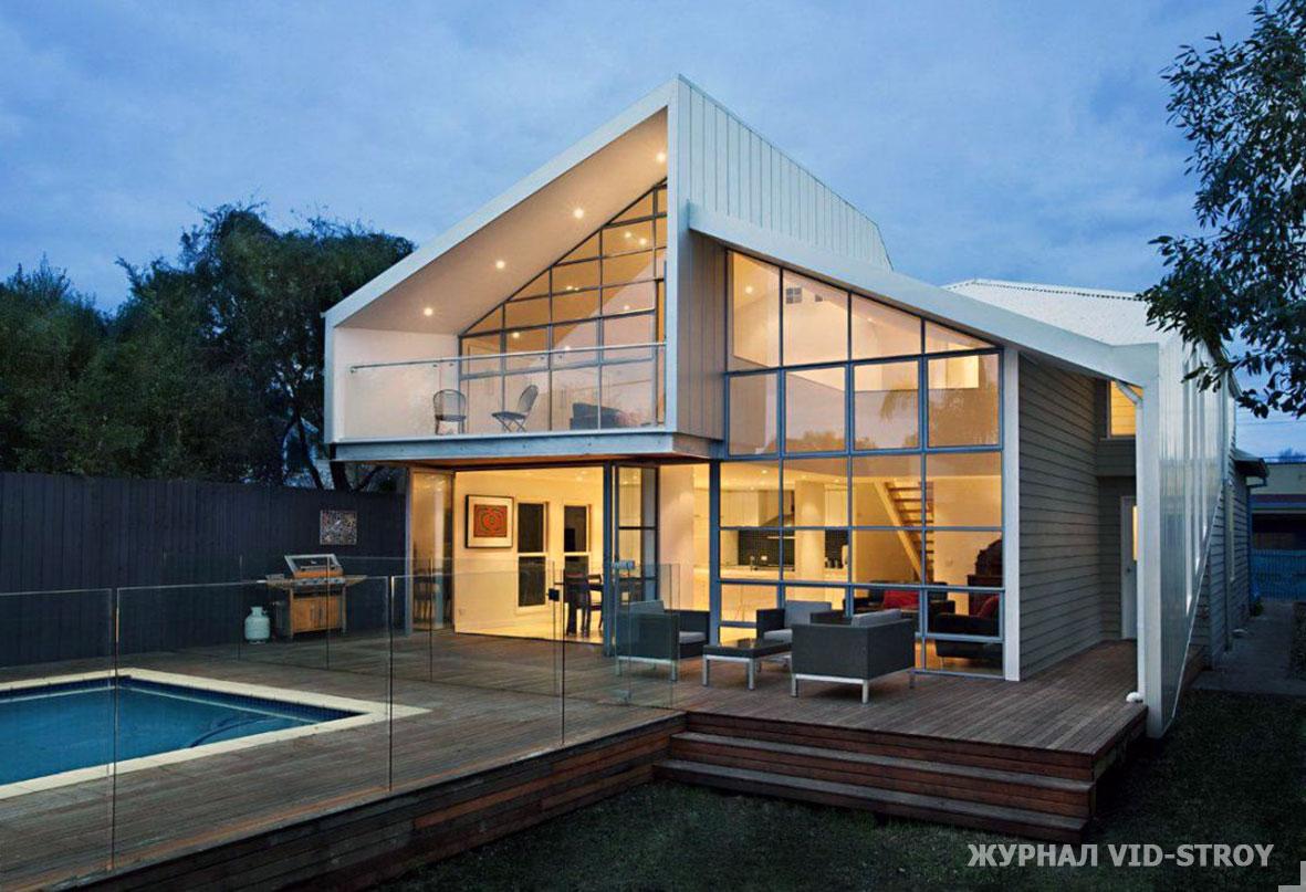 современный дом с большими панорамными окнами